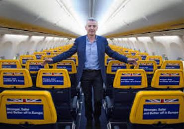 Chief Executive of Ryanair Michael O'Leary standing inside one of his aeroplanes